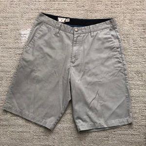Grey Volcom shorts.